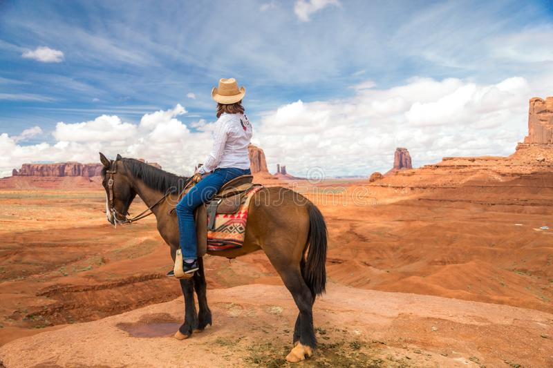 Cowgirl riding horse in Monument Valley Navajo Tribal Park in USA. Cowboy woman on a horse in Monument Valley Navajo Tribal Park in USA stock photography