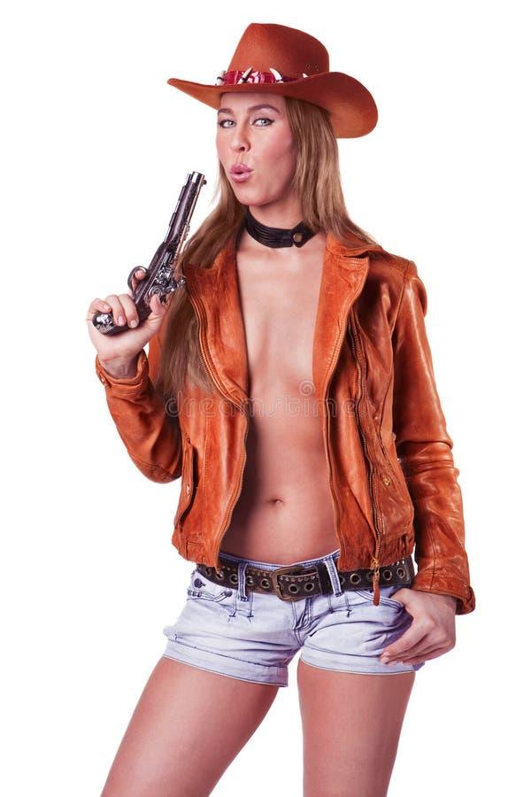 Cowgirl rubio atractivo que sopla un arma aislado fotos de archivo libres de regalías