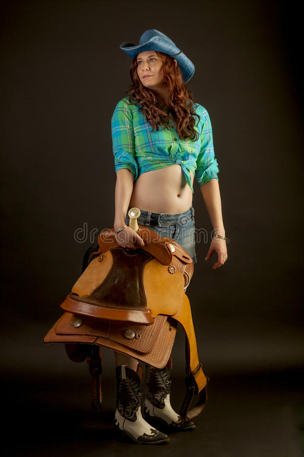Download Cowgirl With A Saddle Stock Photo - Image: 32574260