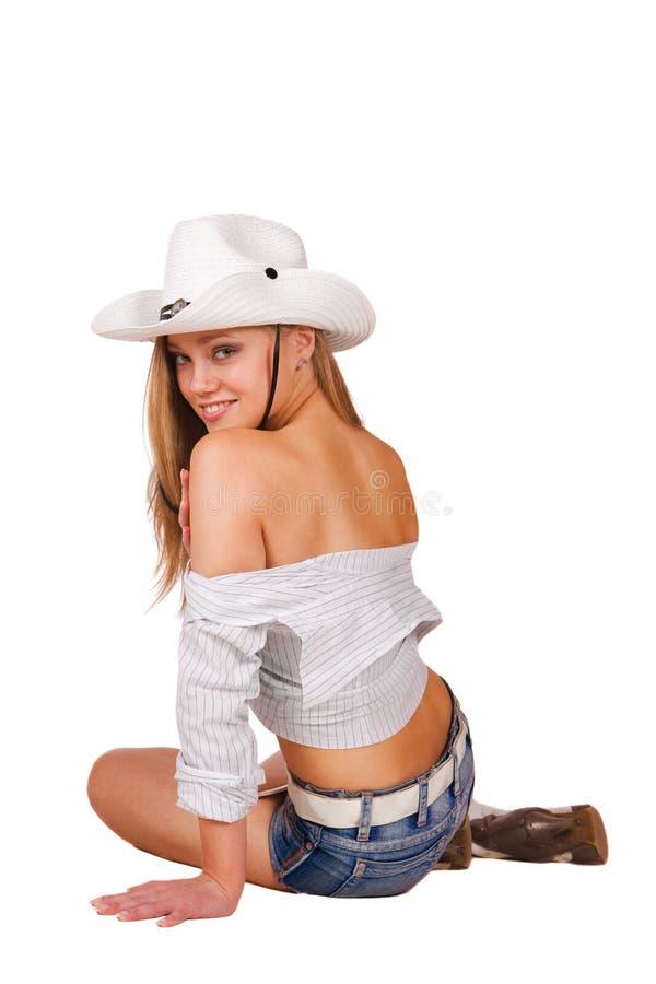 Cowgirl 'sexy' super do rodeio em calças de brim dos shorts, carregadores fotografia de stock royalty free