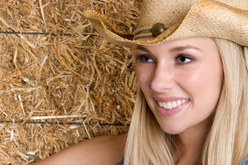 Cowgirl sonriente imagen de archivo