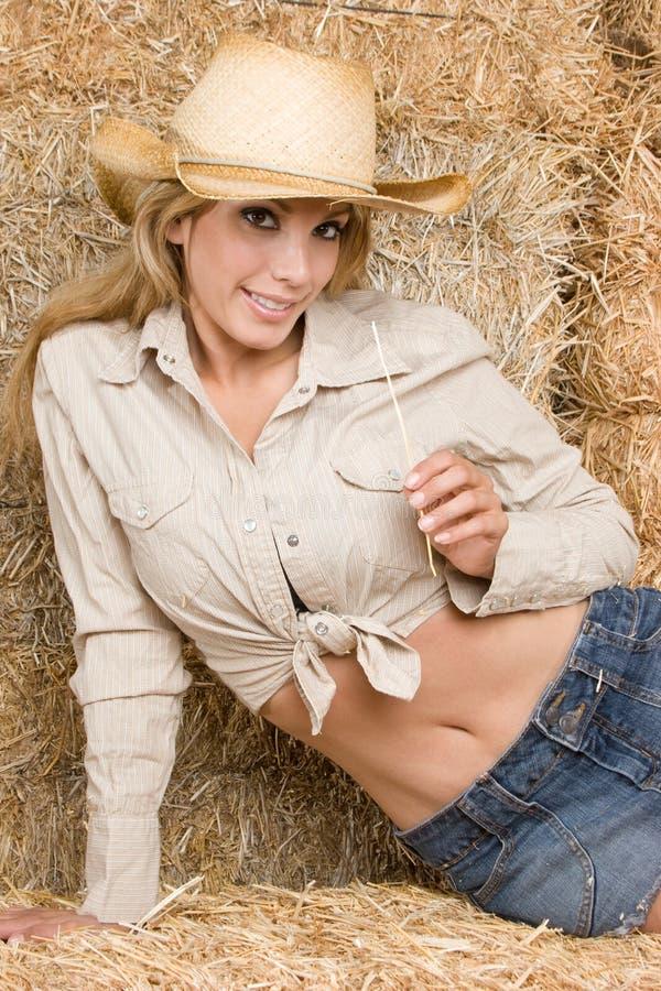 Cowgirl sonriente fotos de archivo