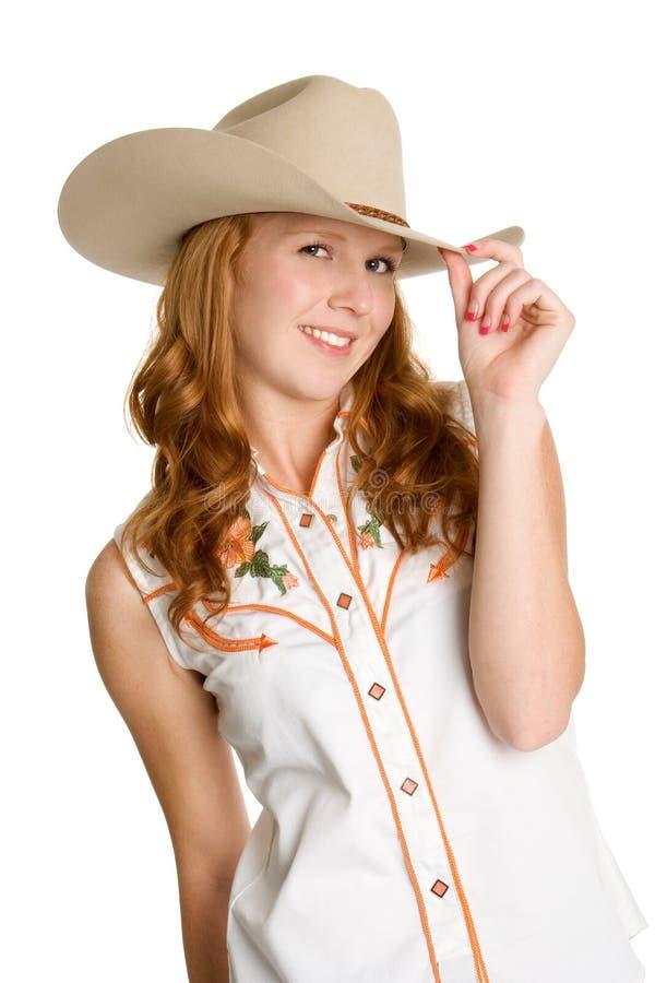 Cowgirl sonriente hermoso foto de archivo