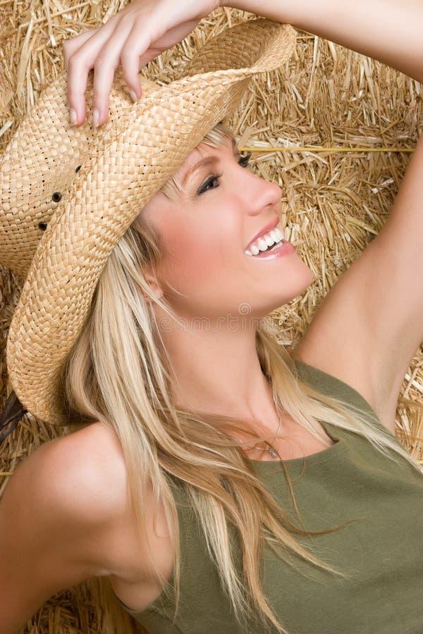 Cowgirl sorridente fotografie stock libere da diritti
