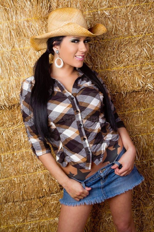 Cowgirl sorridente grazioso immagine stock libera da diritti
