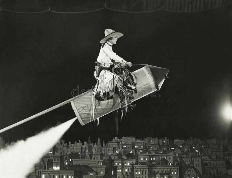 Cowgirl takes off on a rocket stock photo
