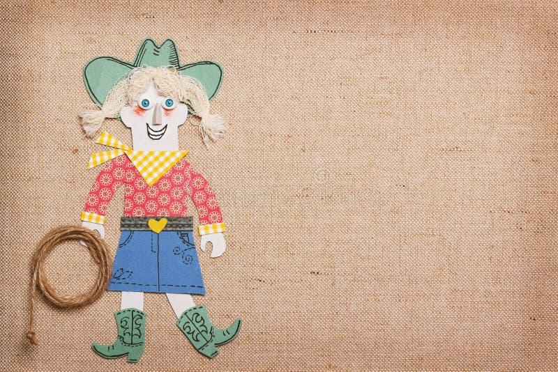 Cowgirl in vestiti occidentali con il lazo del cowboy a disposizione La carta ha tagliato la a illustrazione vettoriale
