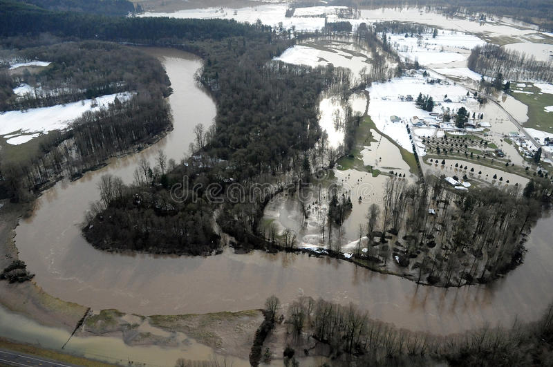 Cowlitz River flooding, Washington state. Water swells from the banks of the Cowlitz River in Washington state royalty free stock photos