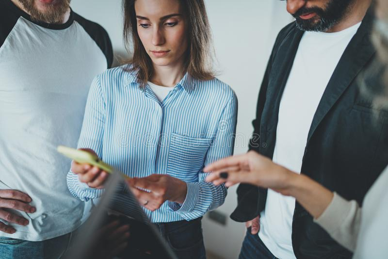 Coworkers business meeting concept.Young women holding mobile phone hand and discussion news with her colleagues. stock photo
