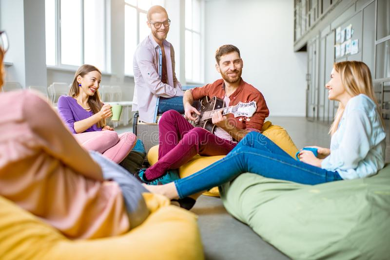 Coworkers having fun in the office stock photos