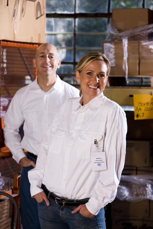 Coworkers in office storage room stock image