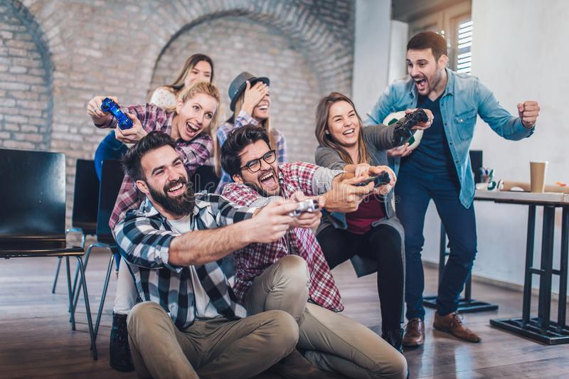 Coworkers playing video games in office. Coworkers playing video games in office having fun stock images