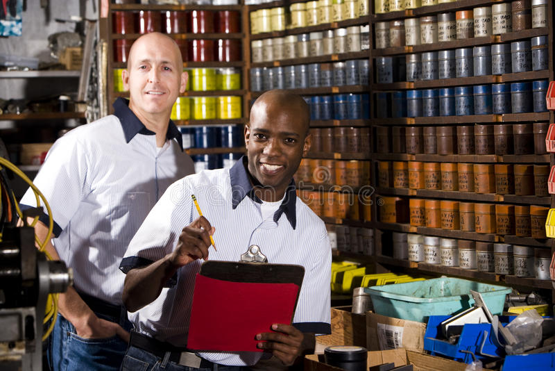 Coworkers In Printshop Royalty Free Stock Photography