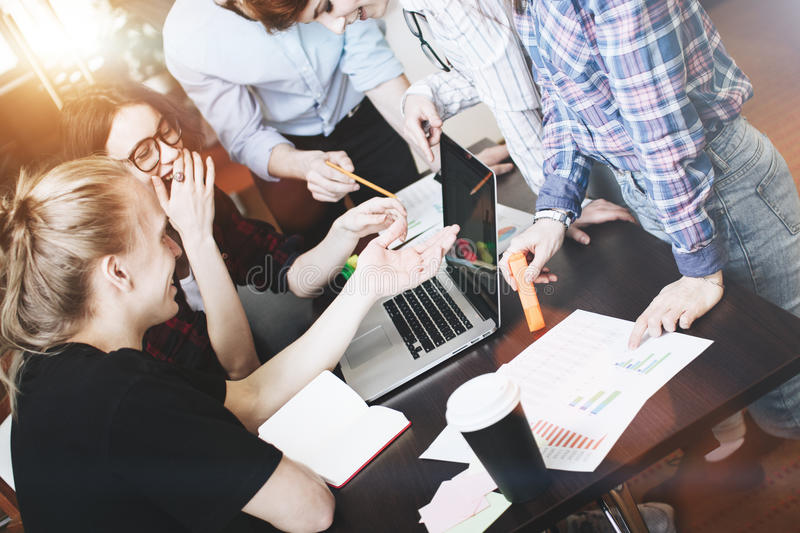 Coworkers Team. Discussing new project. Brainstorming young business team in a modern office royalty free stock photo