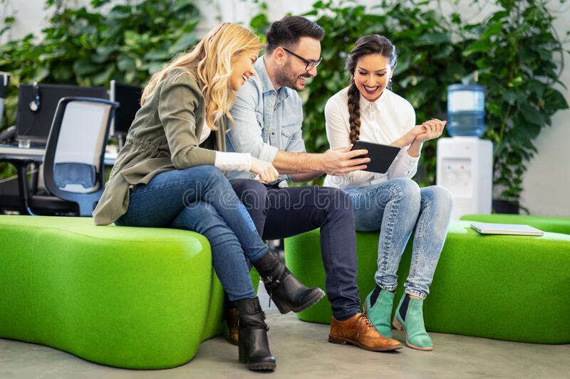Coworkers team working new startup project at modern office. Business meeting concept. stock images