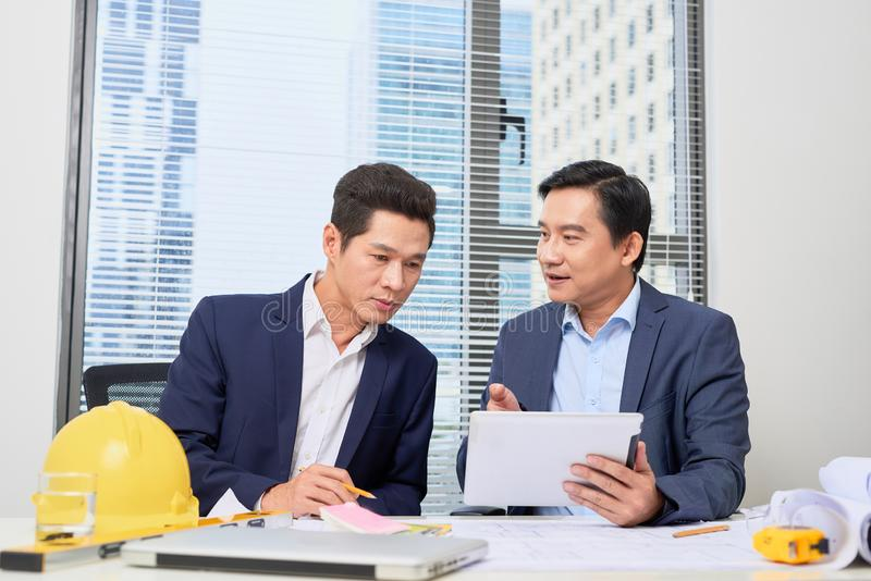 Coworkers working in office. Business people planning over desk royalty free stock photo