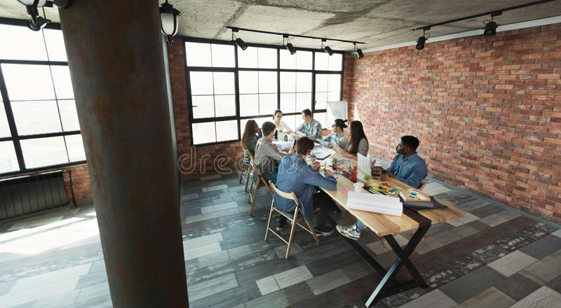 Coworkers working together in modern spacious loft royalty free stock photos
