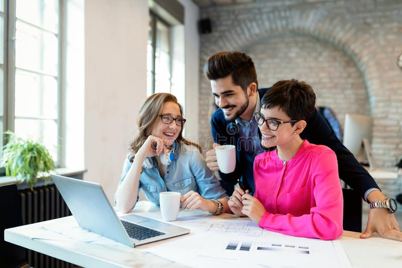 Coworking colleagues having conversation at workplace royalty free stock photos