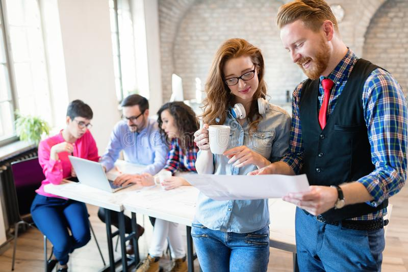 Coworking colleagues having conversation at workplace stock images