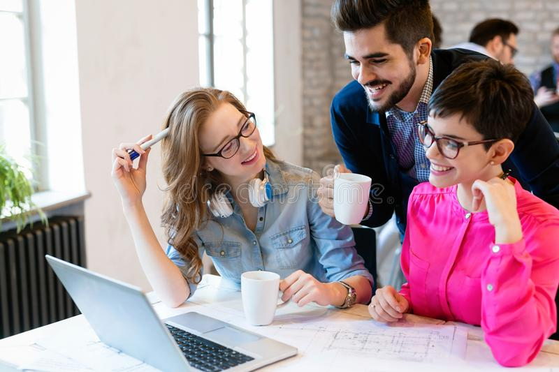Coworking colleagues having conversation at workplace royalty free stock photo