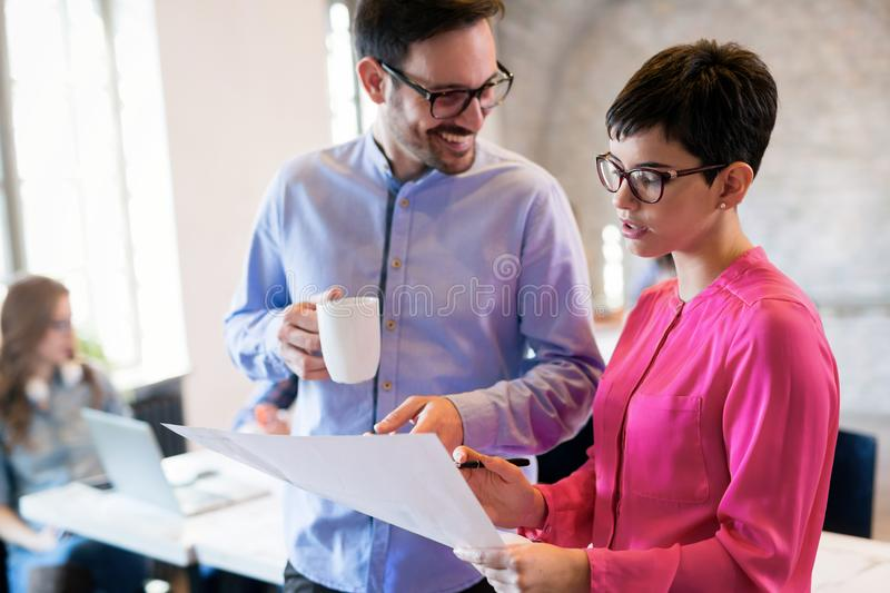 Coworking colleagues having conversation at workplace royalty free stock image