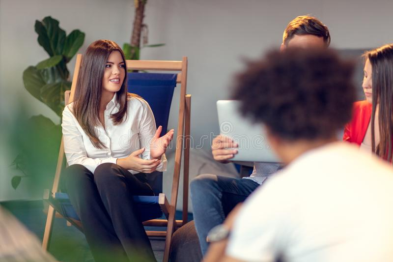 Coworking meeting. Startup team discussing new project together. stock photo