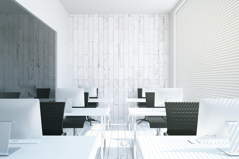 Coworking office interior. With white desks, computers, empty concrete wall and blinds. 3D Rendering royalty free illustration