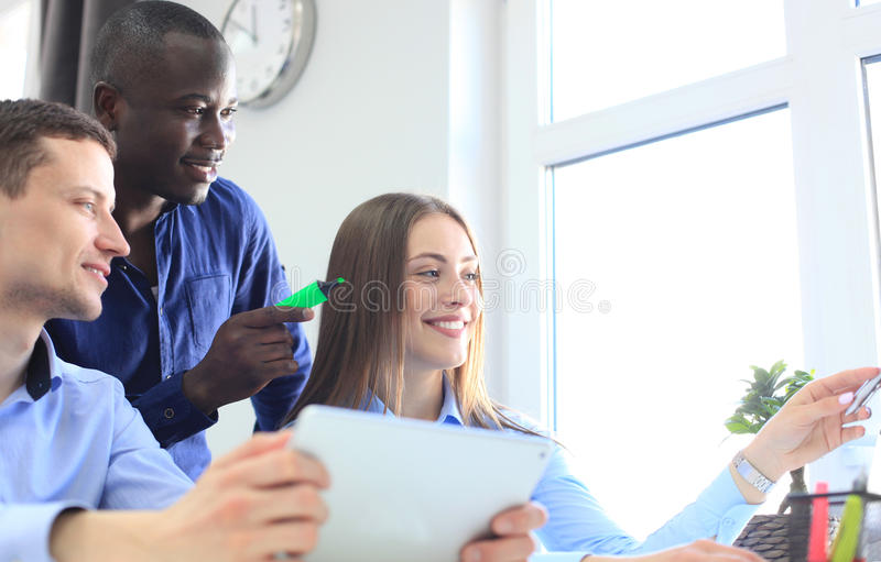 Coworking process, designers team work project. Photo young business crew working with new startup modern office. royalty free stock photo