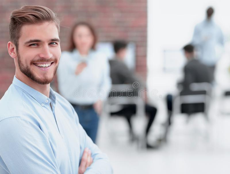 Coworking process, designers team working modern office. Cheerful men smiling in office royalty free stock photo