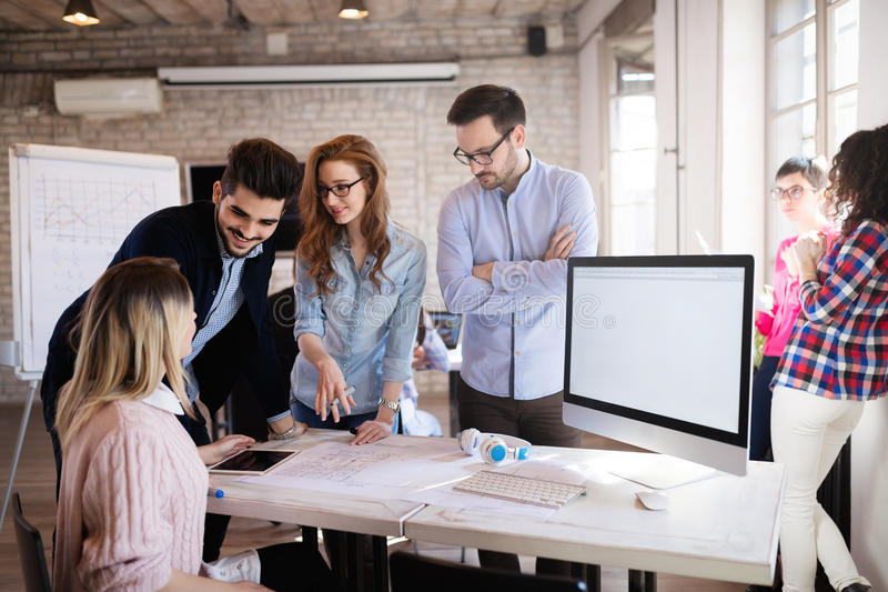 Coworking process, designers team working in modern office stock image