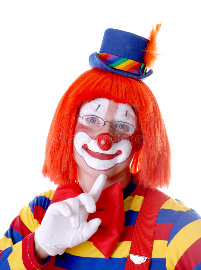 Coy Clown. In Full Circus Makeup With Finger to His Chin stock images