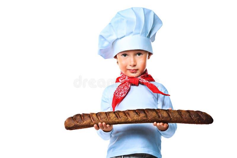 Cozinhando o menino fotografia de stock royalty free