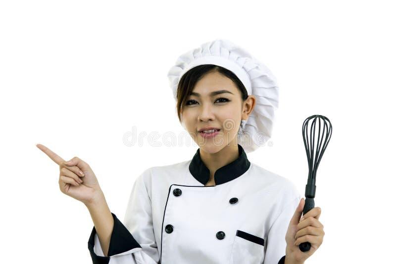 Cozinheiro asiático do cozinheiro chefe da jovem mulher no branco fotos de stock
