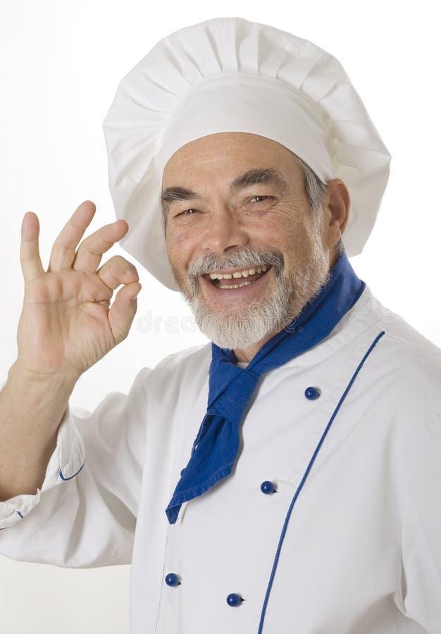 Cozinheiro atrativo feliz fotos de stock