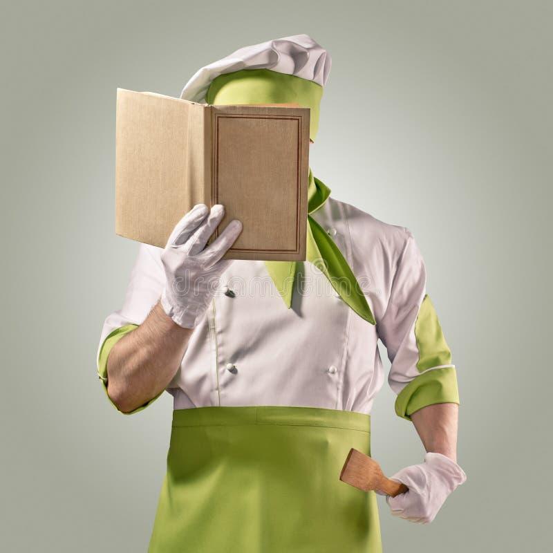 Cozinheiro chefe com livro do cozinheiro fotografia de stock