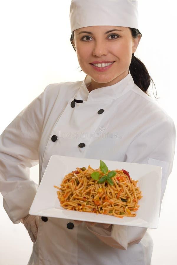 Cozinheiro chefe com massa fotografia de stock