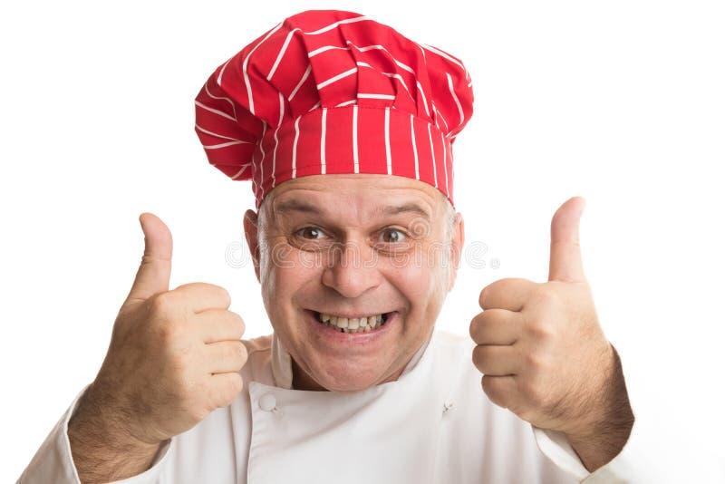 Cozinheiro chefe com o chap?u vermelho que faz express?es fotografia de stock royalty free
