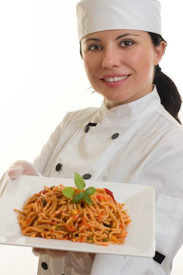 Cozinheiro chefe com refeição foto de stock
