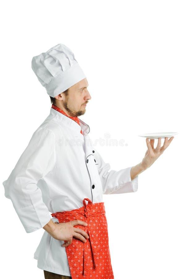 Cozinheiro chefe com um prato imagem de stock royalty free