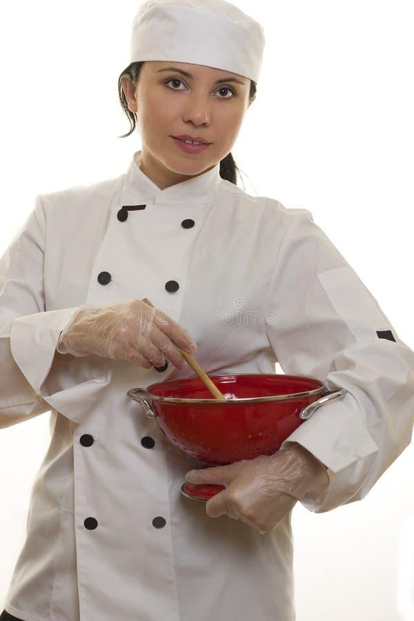 Cozinheiro chefe com utensílios da cozinha foto de stock