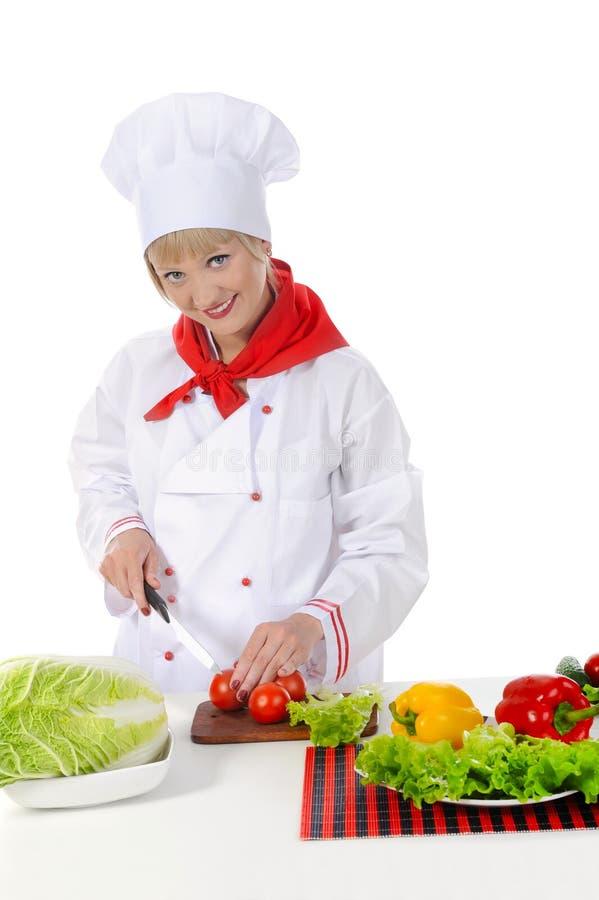 Cozinheiro chefe considerável no uniforme. fotografia de stock royalty free