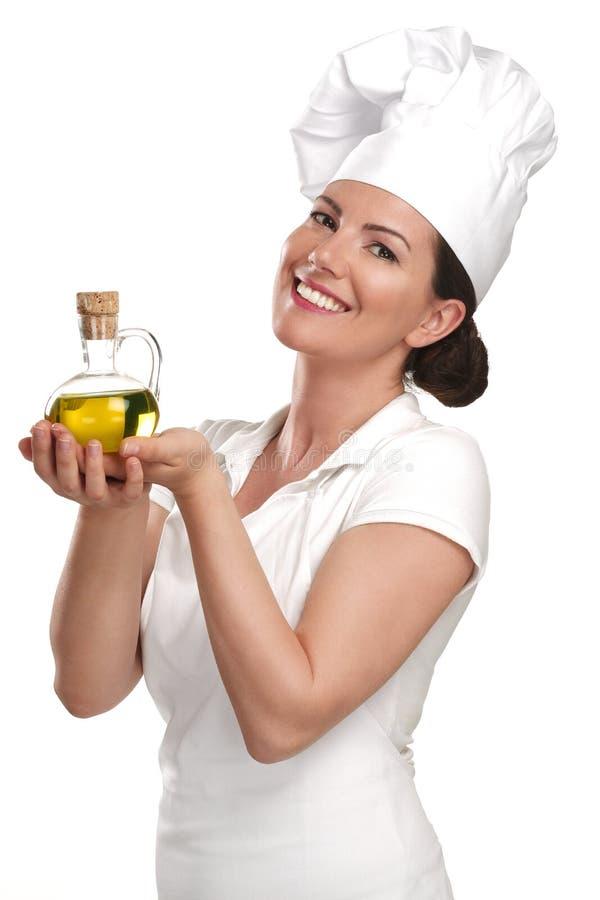 Cozinheiro chefe da jovem mulher que mostra ingredientes para o alimento italiano fotografia de stock