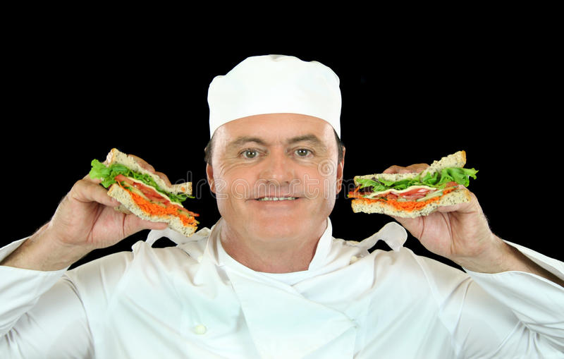 Cozinheiro chefe da terra arrendada do sanduíche fotos de stock royalty free