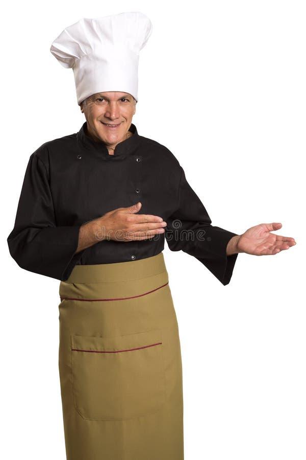 Cozinheiro chefe de sorriso feliz que apresenta seus receitas e produtos fotos de stock