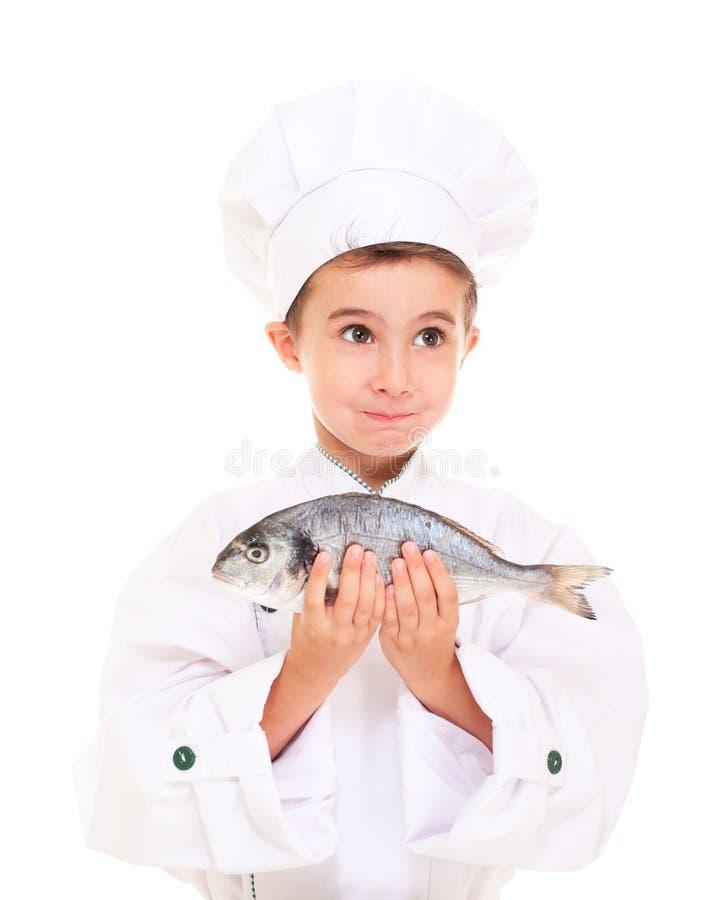 Cozinheiro chefe do rapaz pequeno no uniforme imagens de stock
