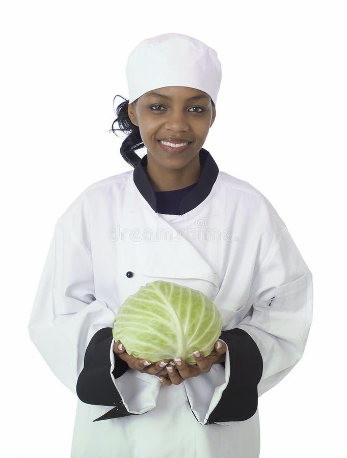 Cozinheiro chefe e repolho fotografia de stock