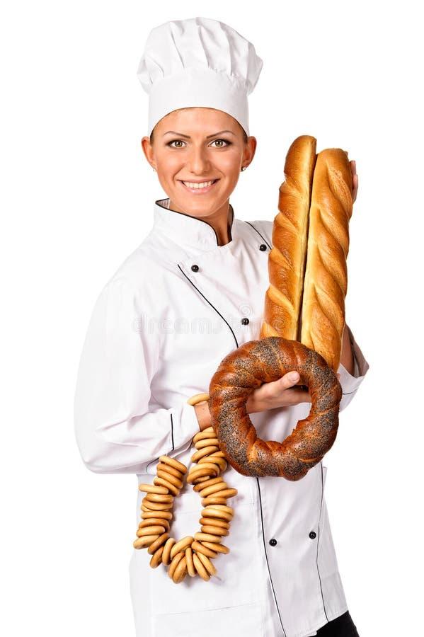 Cozinheiro chefe fêmea bonito que sustenta um pão bonito fotografia de stock royalty free