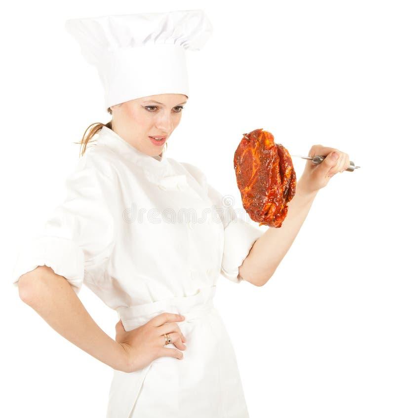 Cozinheiro chefe fêmea com carne foto de stock