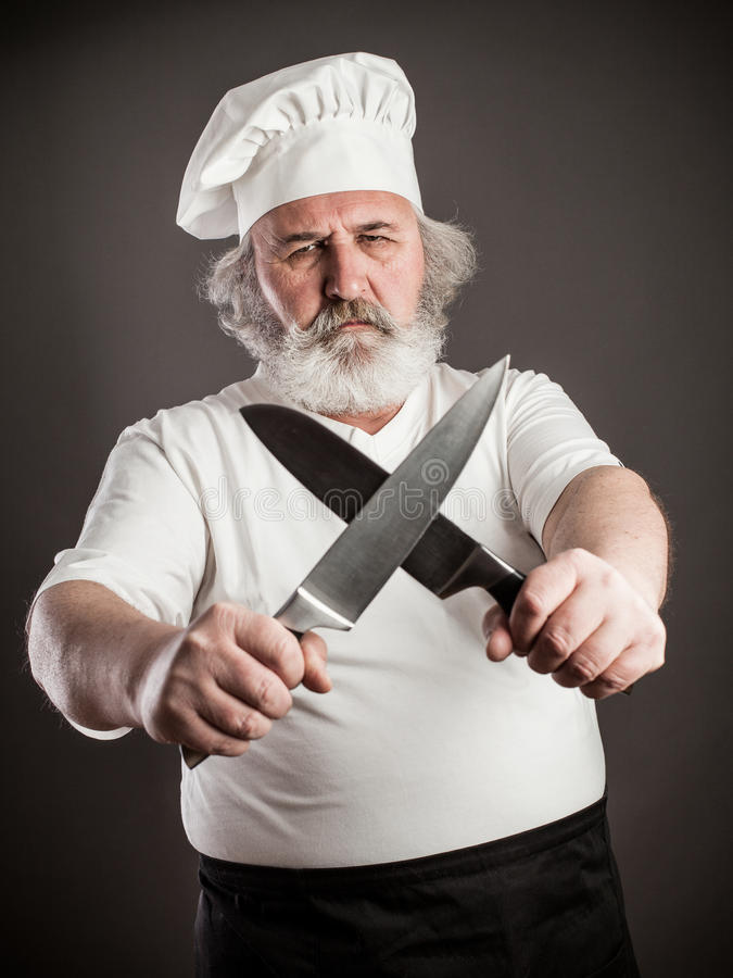 Cozinheiro chefe idoso mal-humorado imagens de stock