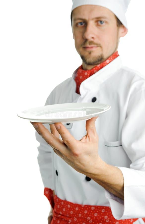Cozinheiro chefe novo com uma placa imagem de stock royalty free
